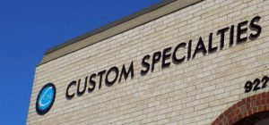 Black metal letter and logo building sign for Custom Specialties Inc in Overland Park KS