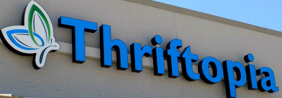 Light up channel letter sign with blue lettering and custom logo in Ottawa KS