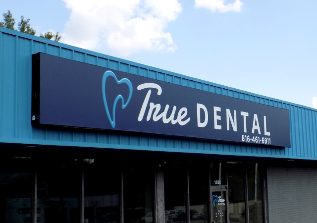 Lighted storefront cabinet sign at True Dental in Independence MO