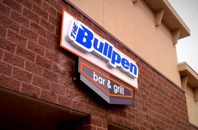 Lighted storefront channel cabinet sign at Bullpen Bar and Grill Overland Park KS