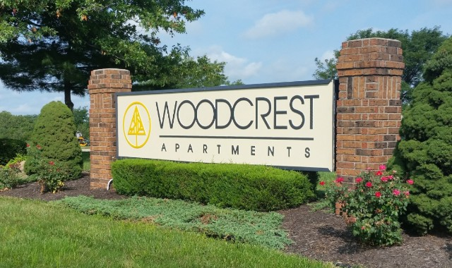 Lighted monument cabinet sign for Woodcrest Apartments in Kansas City MO
