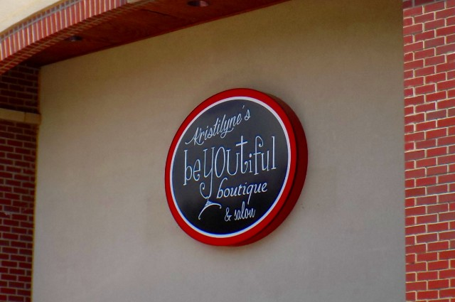 Wall-mounted lighted cabinet sign for KristiLyne's beyoutiful boutique and salon blue springs mo